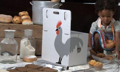Kokerellende kids op kookpit van karton