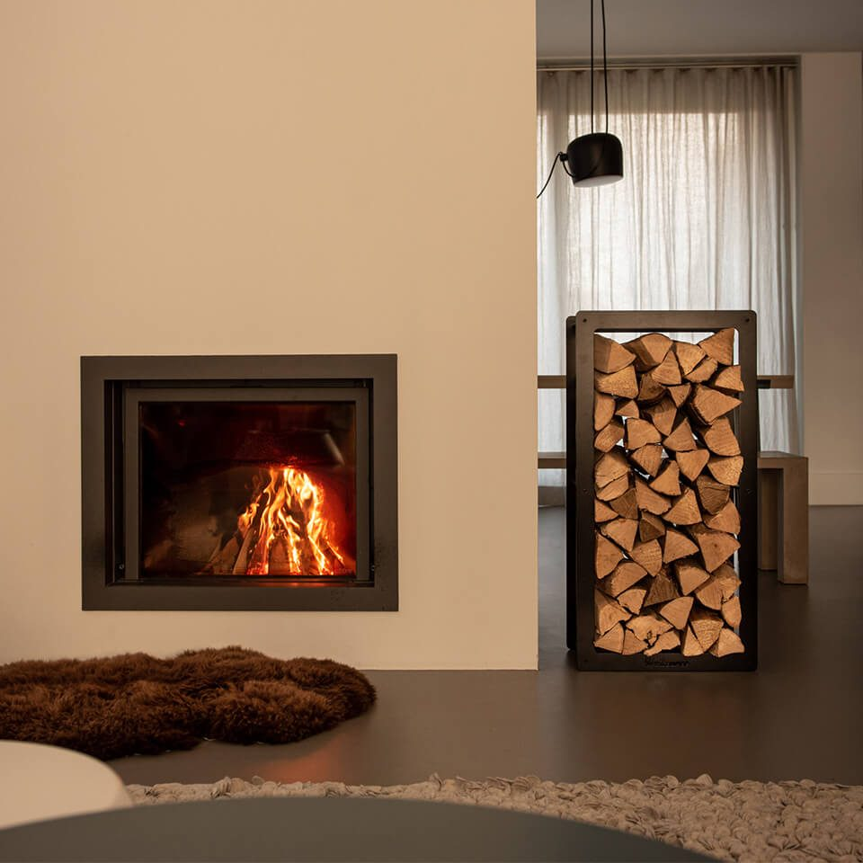 Woodstock Frame Next To Fireplace Filled With Wood